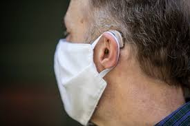 Man wearing face mask and hearing aid